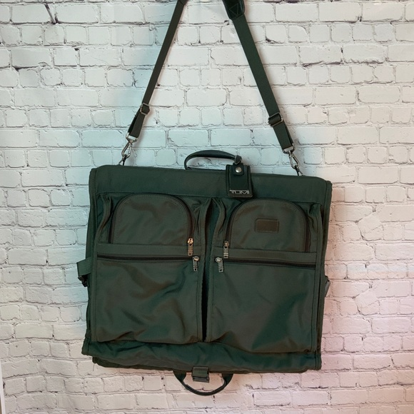Tumi Handbags - $600 TUMI Garment Bi Fold Bag Green 231M3 Travel
